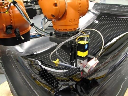 Робот Отпуск оттаиватель линии из-EXATEC спроектирован и построен систему дозирования